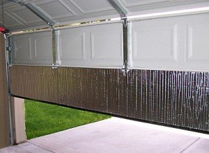 Garage door insulation adds comfort while saving money garage triage foil insulation being installed solutioingenieria Choice Image